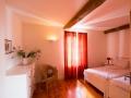 L'Olivier red bedroom